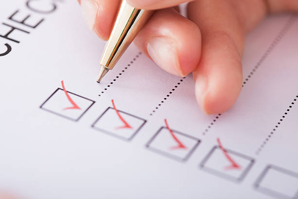 Professional home inspection checklist with red pen and check marks