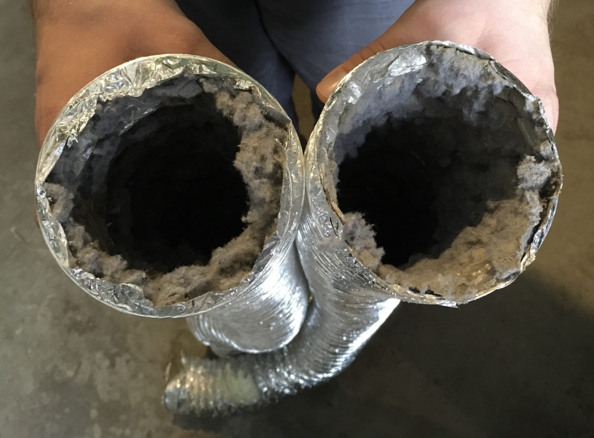 Lint caught in aluminum foil dryer vent hose. Choosing the best dryer vent hose blog article.