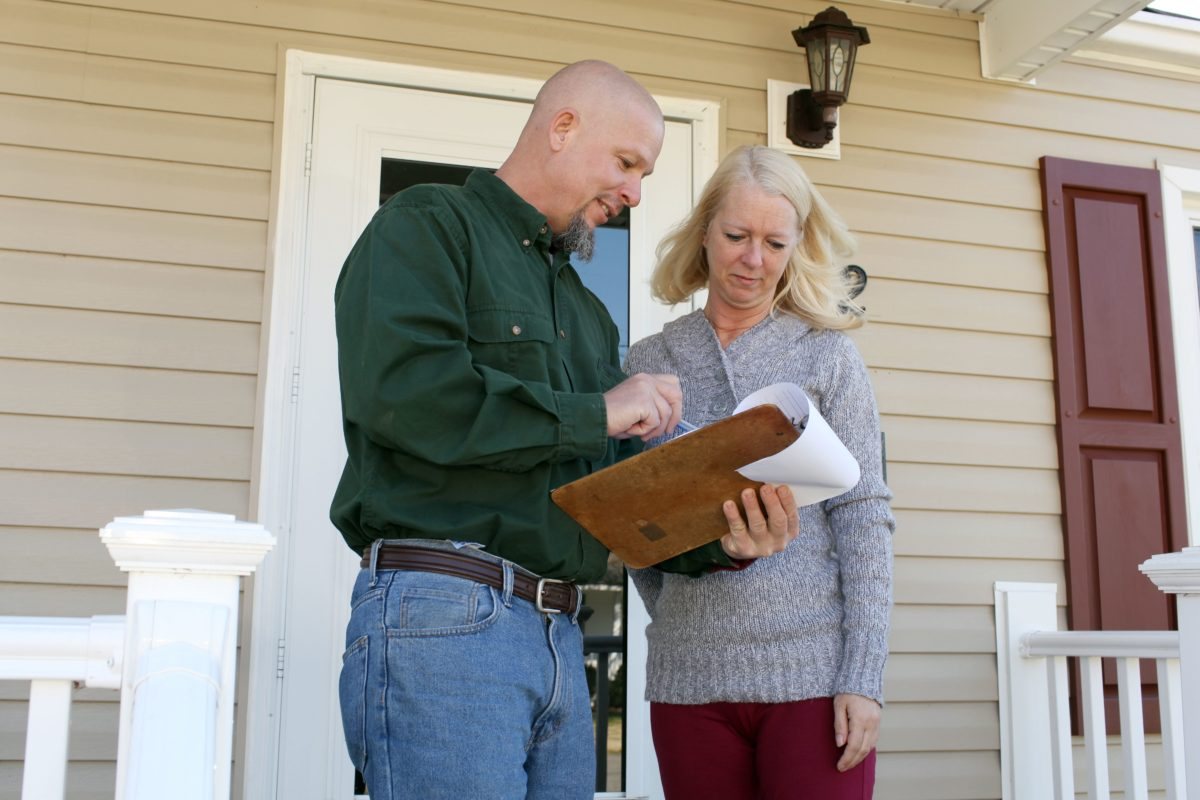 woman with home inspector